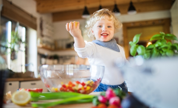 500px Photo ID: 238974251 - Toddler boy in the kitchen. A small boy making a vegetable salad.
