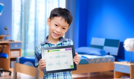 Little boy smiles with tablet computer